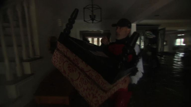 Jim Higgins moved furniture to the top of his house as the flood waters rose