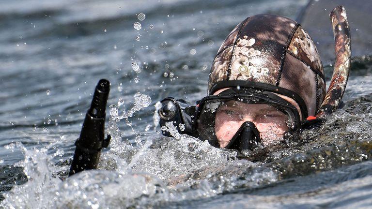 Putin spearfishes in the remote Tuva region in southern Siberia