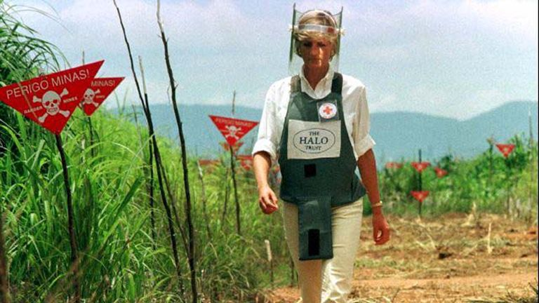 Jan 1997: Diana walks in a safety corridor of the landmine field in Huanbo, Angola during a visit to help a Red Cross campaign outlaw landmines worldwide