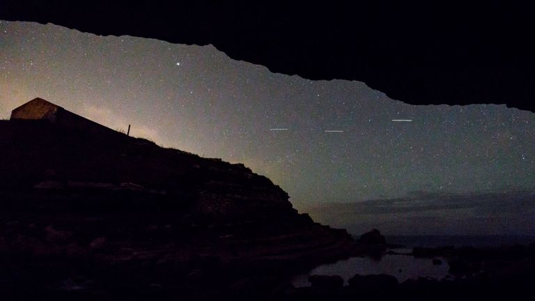 This picture taken on August 12, 2017 shows a Perseid meteor along the Milky Way illuminating the dark sky near Comillas, Cantabria community, northern Spain, during the 'Perseids' meteor shower