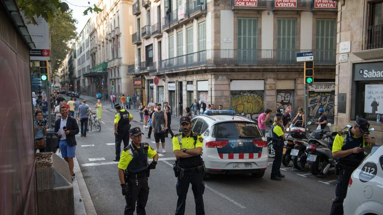 People return to Las Ramblas amid a high police presence after the attack