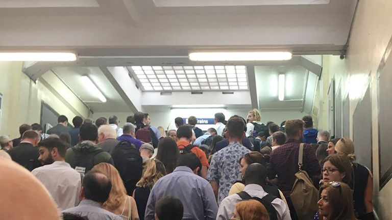 Commuters at Surbiton station who were among those caught up in disruption from the late-running of work at Waterloo
