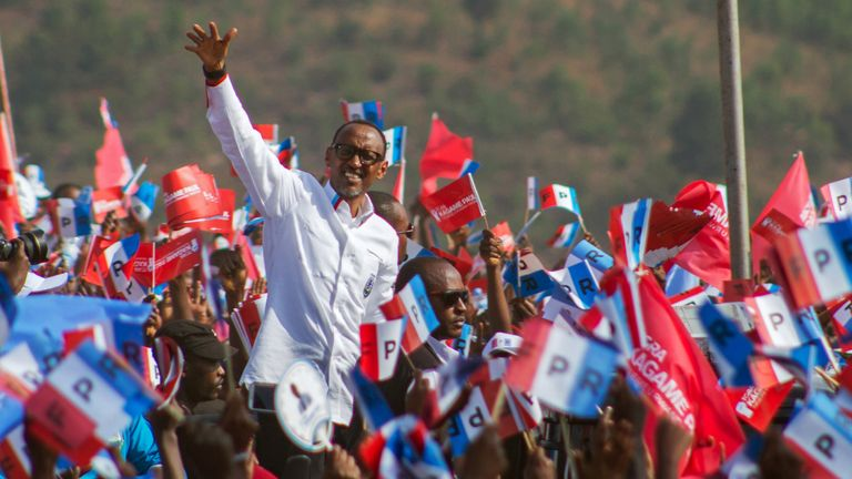 Paul Kagame waves to his supporters during his final campaign rally in Kigali, Rwanda