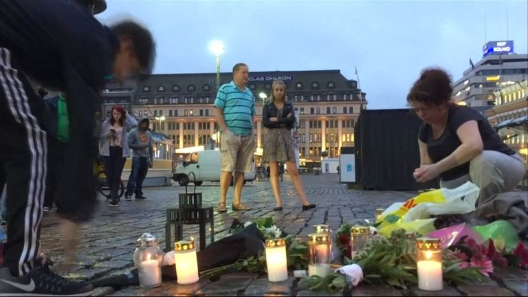 People lay tributes at the scene of the attack