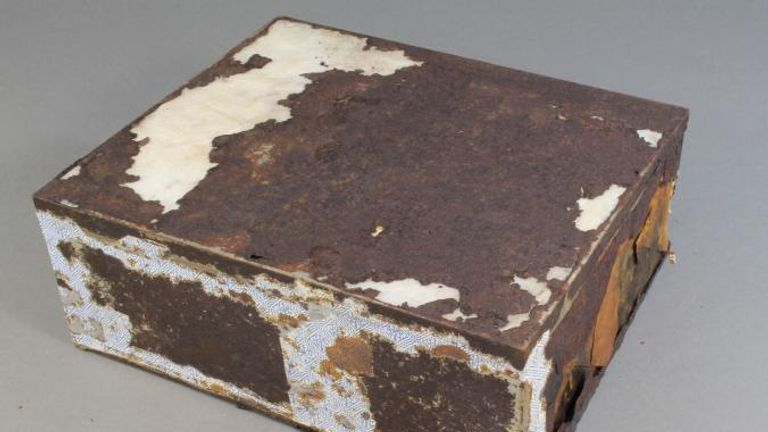 The tin containing the cake was heavily damaged. Pic: Antarctic Heritage Trust