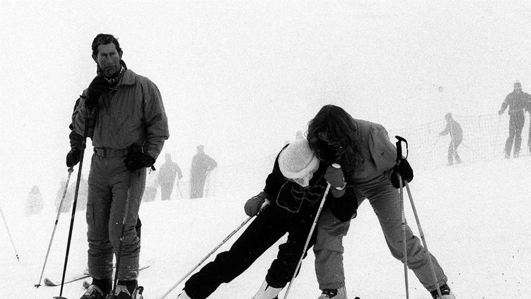 Feb 1987: Charles watches Diana and The Duchess of York in the snow at Klosters in the Swiss Alps