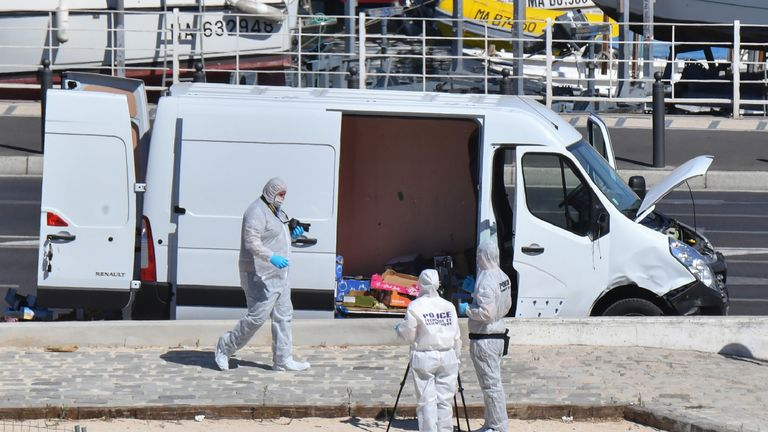 Forensic officers investigate a van in Marseille