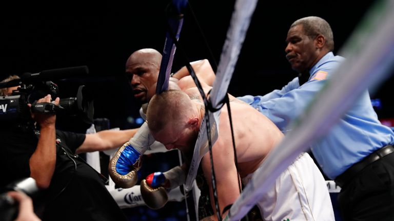 The referee steps in as Mayweather finally overwhelms his opponent