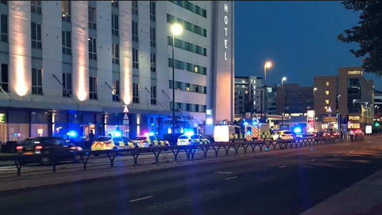Police and ambulance lined up outside the Ibis Hotel, Salford Quays Pic: @jmagudom