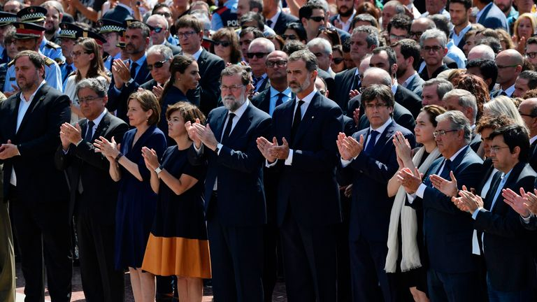 Spain's King Felipe VI is joined by hundred of people in Barcelona for a minute's silence