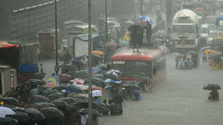 Wading through a flooded street in Mumbai