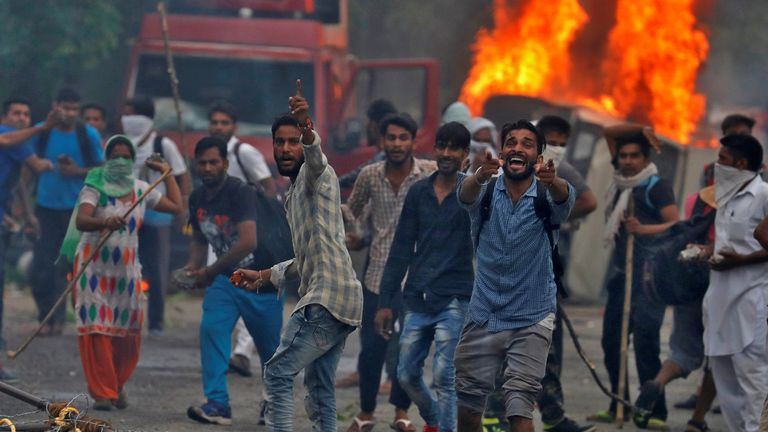 Riots in India after the conviction of a guru for rape