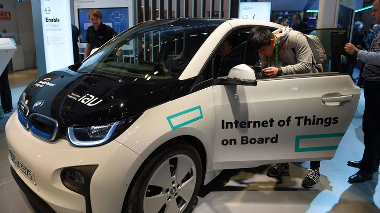 Visitors test a car with internet connection during the Mobile World Congress in Barcelona, 2016