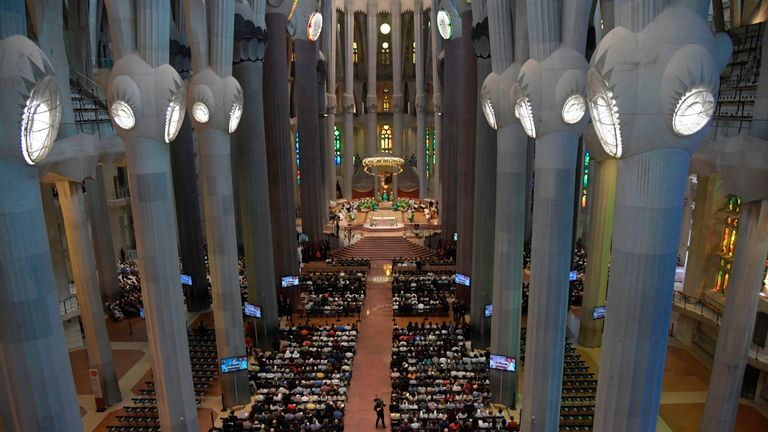 People attend a mass to commemorate victims of two devastating terror attacks in Barcelona and Cambrils