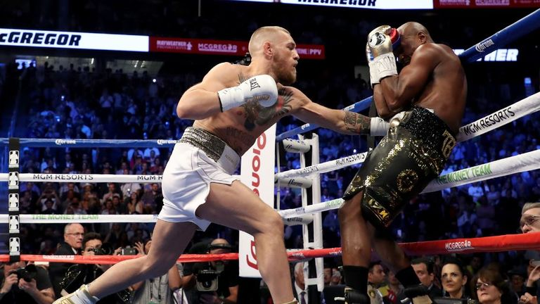 Conor McGregor throws a punch at Floyd Mayweather Jr. during what some are calling the fight of the century