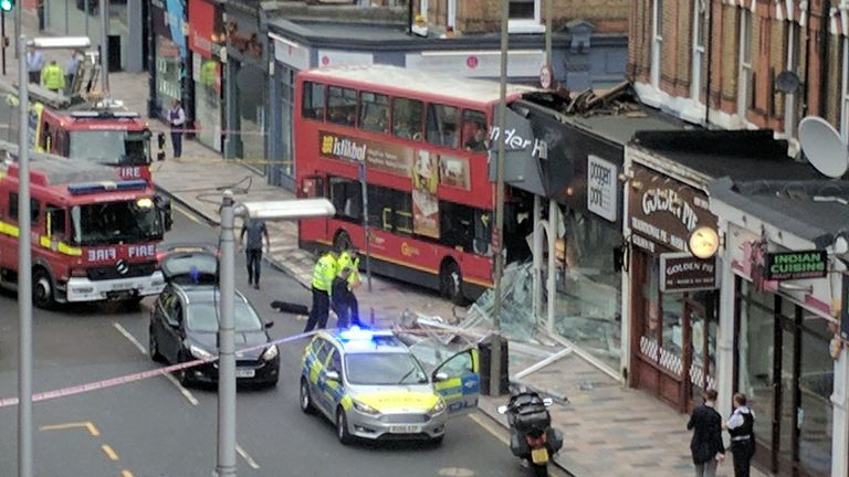 The scene after a double decker bus crashed into a shop in Lavender Hill