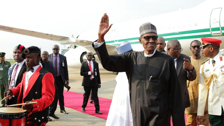 Ailing Nigerian President Mohammadu Buhari walks to the presidential lounge on his return back to the country in Abuja, on August 19, 2017