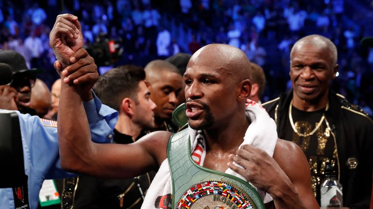 Undefeated world champion Mayweather claims the belt after a technical knockout