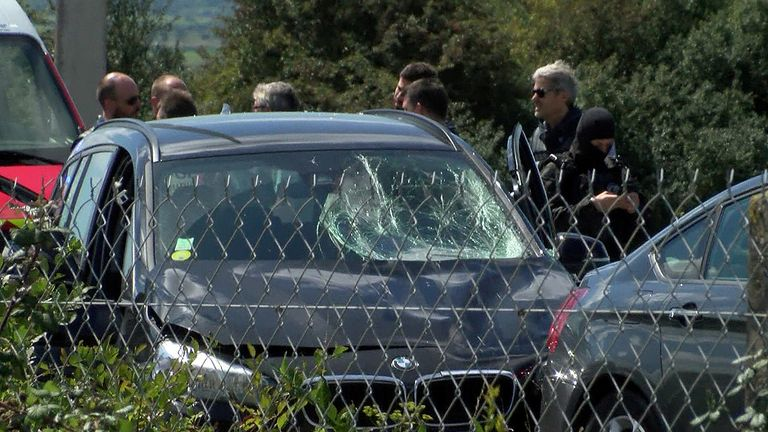 A still image taken from a video shows heavily armed French police at the scene where the man suspected of ramming a car into a group of soldiers on Wednesday in the Paris suburb of Levallois-Perret was shot and arrested on the A16 motorway, near Marquise, France, August 9, 2017. REUTERS/Reuters TV