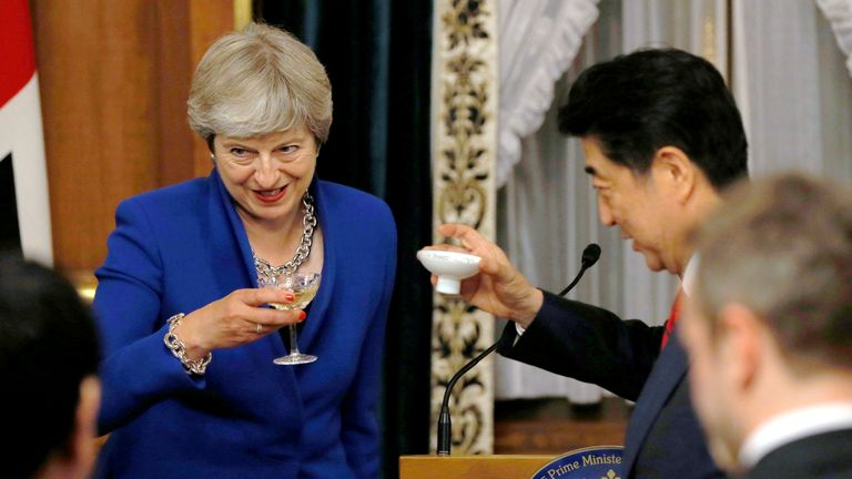 Prime Minister Theresa May toasts her Japanese counterpart Shinzo Abe