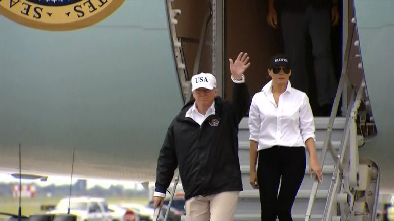 Donald Trump descends the steps of AIr Force One in Texas