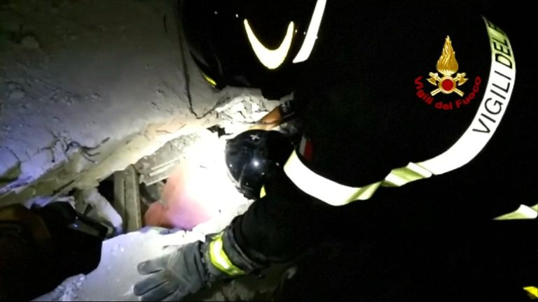 A man is pulled from a collapsed building after the earthquake in Ischia