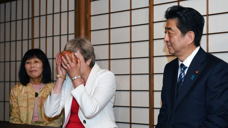 Theresa May takes part in a tea ceremony in Kyoto with Japanese Prime Minister Shinzo Abe