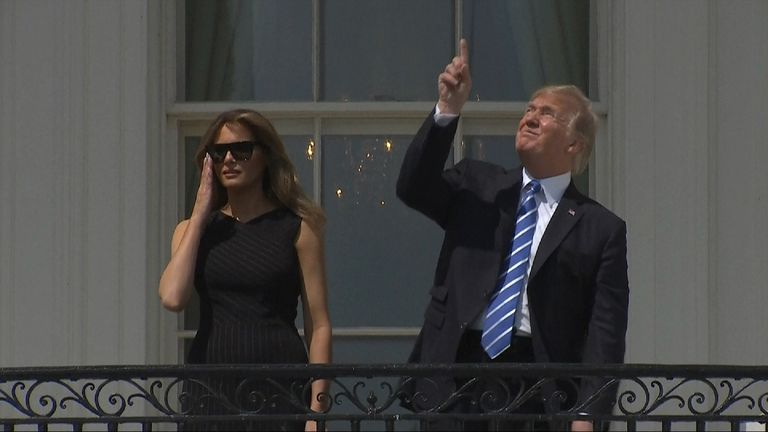 DONALD TRUMP LOOKING AT THE ECLIPSE WITH NO GLASSES