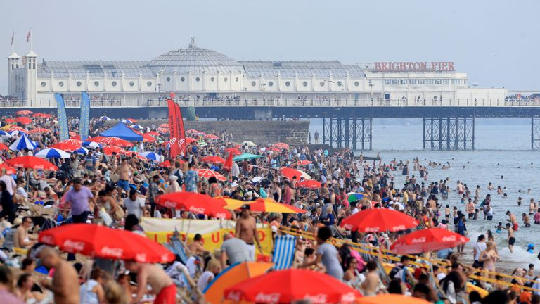 Sunbathers enjoy the heat on Brighton beach