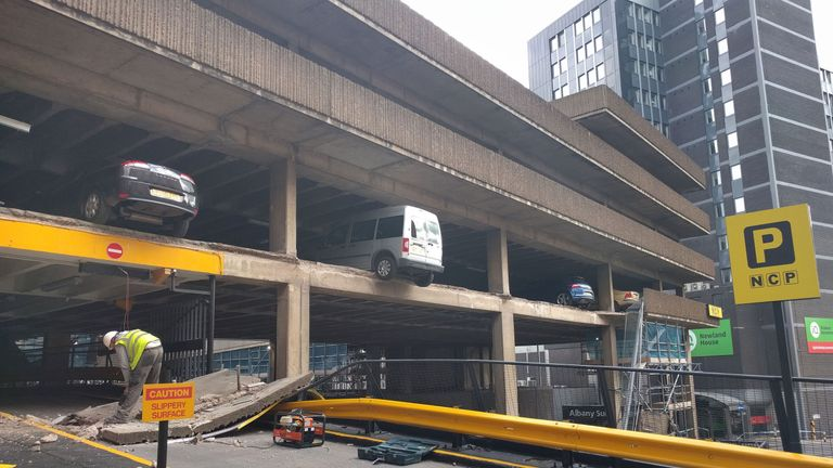 A vehicle's wheels appear to be hanging over the edge