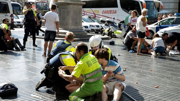 Medical staff help people injured in the attack