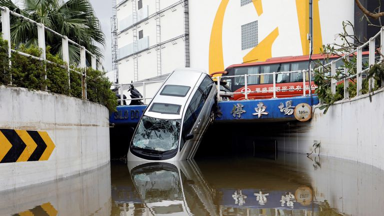 A vehicle damaged by Typhoon Hato is seen in Macau, China