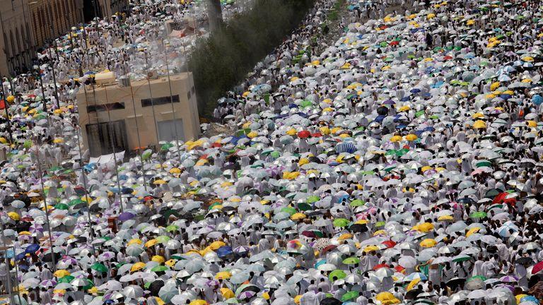 Muslim pilgrims pray outside Namira Mosque on the plains of Arafat during the annual haj pilgrimage