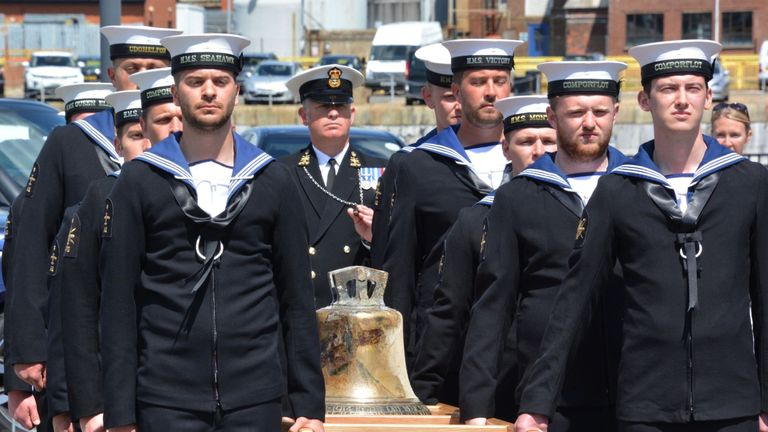 May 2016 The bell from HMS Hood is carried by a Royal Navy guard at Portsmouth Historic Dockyard after it was unveiled by the Princess Royal to mark the 75th anniversary of the Royal Navy's largest loss of life from a single vessel.