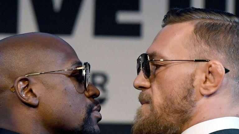 Boxer Floyd Mayweather Jr. (L) and UFC lightweight champion Conor McGregor face off during a news conference at the KA Theatre at MGM Grand Hotel & Casino on August 23, 2017 in Las Vegas, Nevada