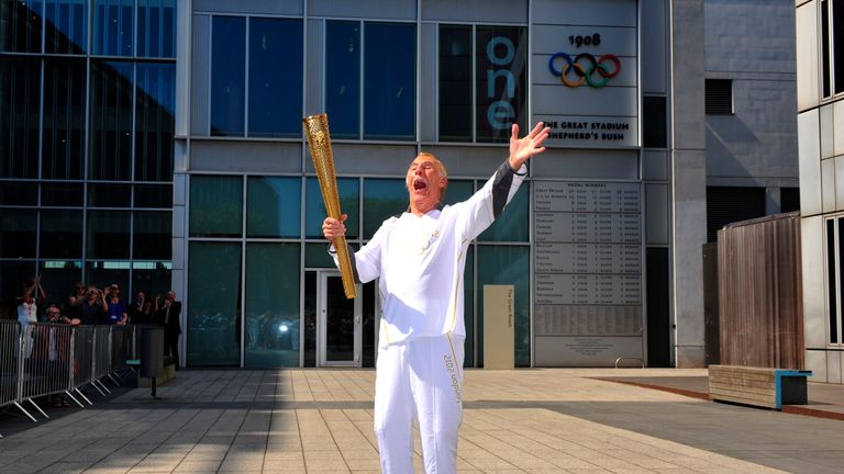 Forsyth carries the Olympic Flame through Kensington ahead of the 2012 London Games