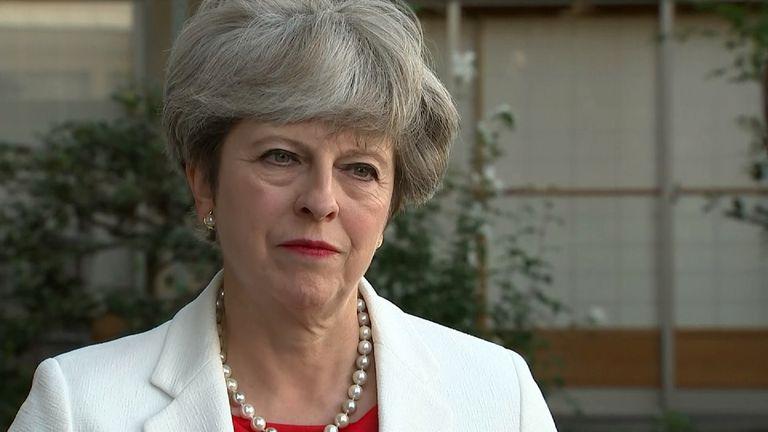 Theresa May talking in Japan.