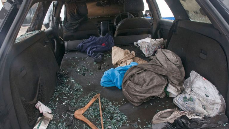 The scene in Mr Meshi's car after the flare was thrown in