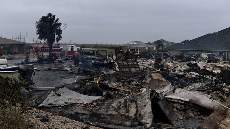 A burnt out house and cars that caught fire are seen after Hurricane Harvey hit Corpus Christi, Texas on August 26, 2017. Hurricane Harvey slammed into the Texas coast late Friday, unleashing torrents of rain and packing powerful winds, the first major storm to hit the US mainland in 12 years. / AFP PHOTO / MARK RALSTON (Photo credit should read MARK RALSTON/AFP/Getty Images)