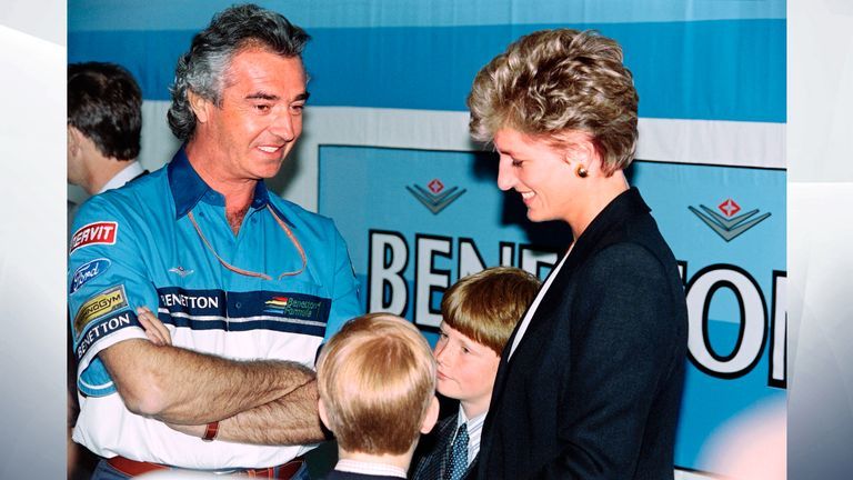 July 1994: Diana and Harry talk with Flavio Briatore, team manager for the Benetton Ford F-1 before the start of the British Grand Prix at the Silverstone