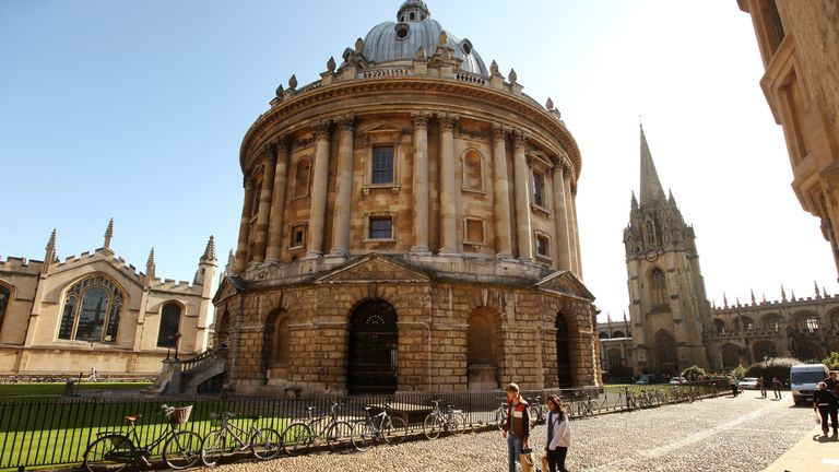 OXFORD, ENGLAND - OCTOBER 08: Students walk past the Radcliffe Camera building in Oxford city centre as Oxford University commences its academic year on October 8, 2009 in Oxford, England. Oxford University has a student population in excess of 20,000 taken from over 140 countries around the world.