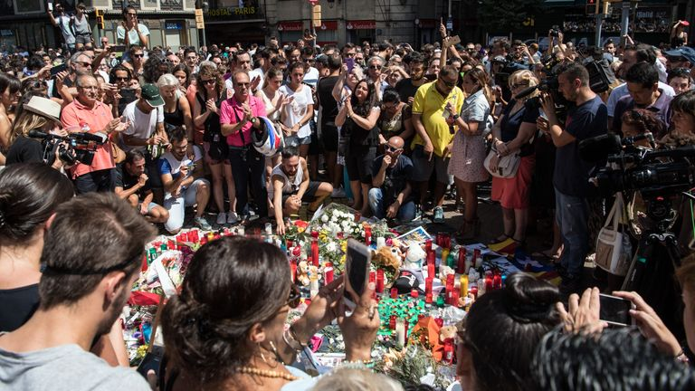 People gather around tributes laid on Las Ramblas