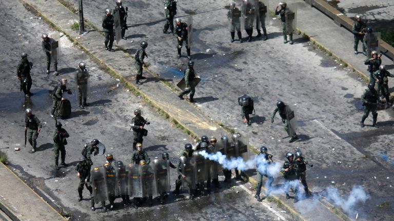 Security forces members clash with opposition demonstrators