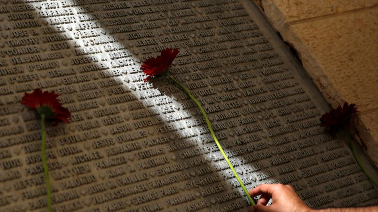 A flower is laid on a monument engraved with names of those who died on 9/11. File pic