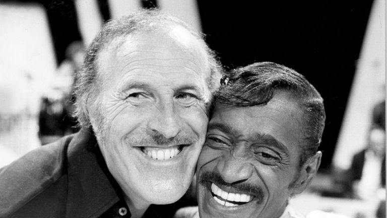 The entertainer with singer and dancer Sammy Davis Jnr in 1980