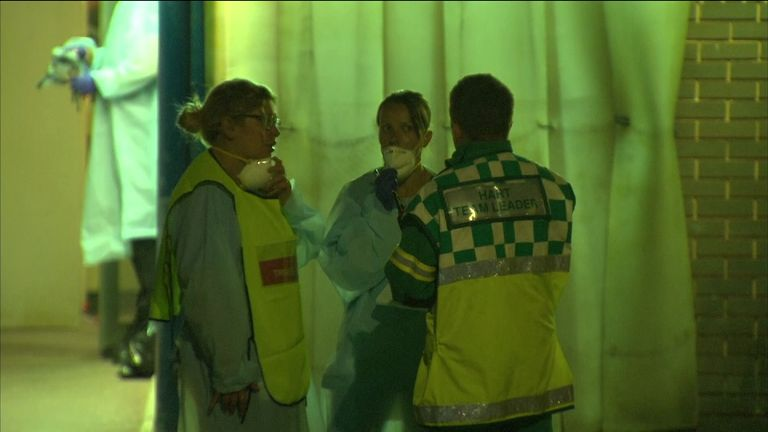 GV's of medical employees wearing masks outside the Hospital affected by the chemical haze.