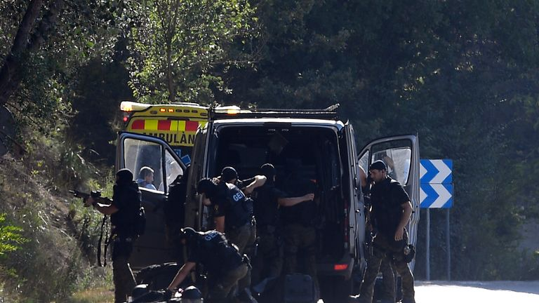 Police at the scene where Moroccan suspect Younes Abouyaaqoub was shot near Sant Sadurni d'Anoia, west of Barcelona