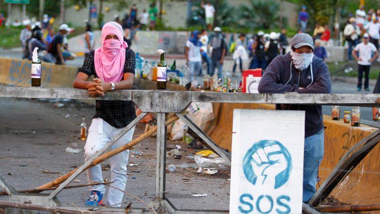 Demonstrators man a barricade