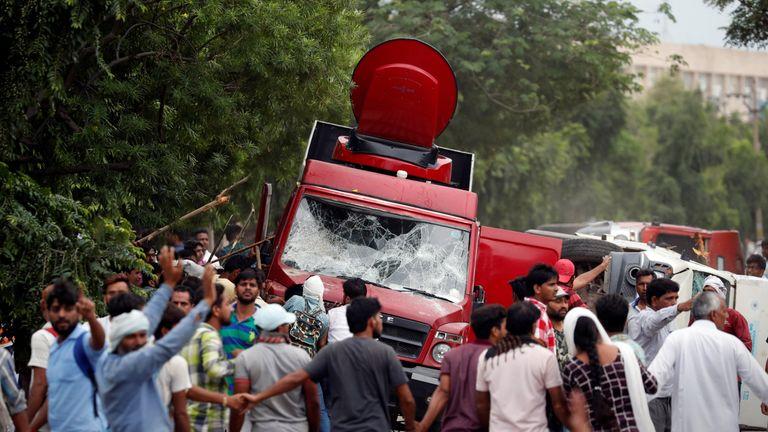 Rioters smash television trucks during violence in Panchkula, India,