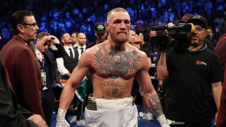 McGregor stands in the ring after his defeat in the 10th round